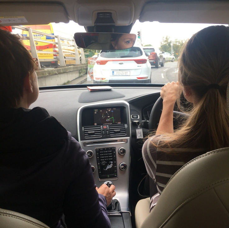 "alt=""two women driving a car in Dublin"""